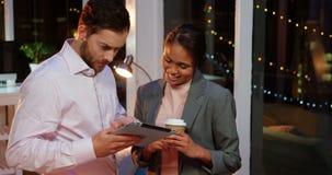 Businesspeople using digital tablet stock footage