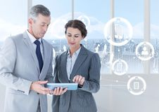 Businesspeople using digital tablet with multiple models interface against cityscape background. Digital composite of businesspeople using digital tablet with Stock Image
