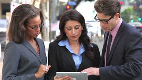 Businesspeople Using Digital Tablet Outside Royalty Free Stock Photography