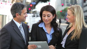 Businesspeople Using Digital Tablet Outside stock footage