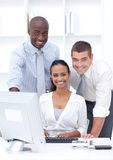 Businesspeople using a laptop Stock Photography