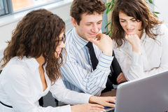 Businesspeople using laptop Stock Image