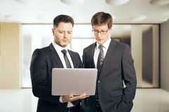 Businesspeople using laptop Stock Images