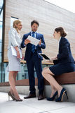 Businesspeople using laptop and digital tablet Royalty Free Stock Image