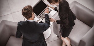 Businesspeople using laptop. High angle view of businesspeople using laptop in office Royalty Free Stock Photography