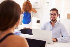 Businesspeople Using Laptop In Office Of Start Up Business Royalty Free Stock Image