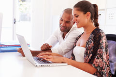 Businesspeople Using Laptop In Office Of Start Up Business Royalty Free Stock Images