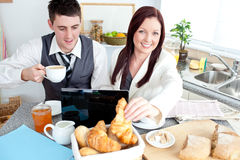 Businesspeople using laptop during their breakfast Stock Image