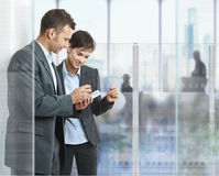 Businesspeople using mobile royalty free stock photo