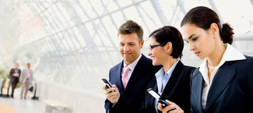 Businesspeople Using Mobile Phone Stock Image