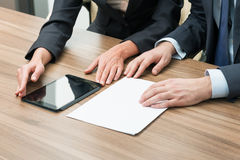 Businesspeople using tablet stock image
