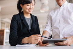Businesspeople using touchscreen computer in office Stock Image