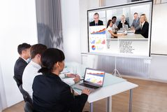 Businesspeople in video conference Stock Image