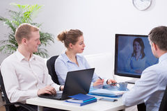 Businesspeople and video conference Stock Photo