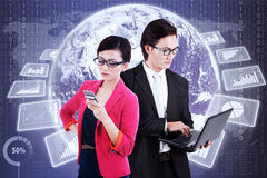 Businesspeople with virtual financial statistics Royalty Free Stock Image