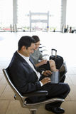 Businesspeople waiting in airport Stock Photography