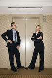 Businesspeople Waiting For Elevator Royalty Free Stock Image