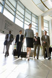 Businesspeople walking in airport Royalty Free Stock Images
