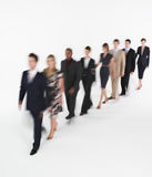 Businesspeople Walking In Blurred Effect Stock Photo