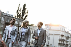 Businesspeople walking in city on sunny day Royalty Free Stock Image