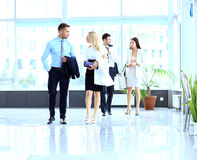 Businesspeople walking in the corrido Stock Photography