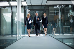 Businesspeople walking in the office Stock Photo