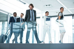 Businesspeople walking in office Royalty Free Stock Photo