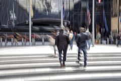 People walking past a office building stock photos