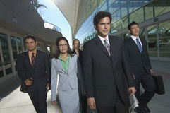 Businesspeople Walking Past Office Building Stock Photography