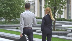 Businesspeople walking on the street of an business center. slow motion. Two business colleagues in discussion, businesspeople walking on the street of an stock video footage