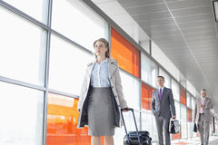 Businesspeople walking on train platform Royalty Free Stock Photography