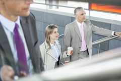 Businesspeople walking up stairs in train station Royalty Free Stock Photo
