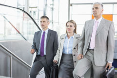 Businesspeople walking up stairs in train station Stock Images