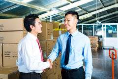 Businesspeople in warehouse have a deal Stock Images