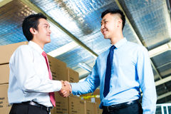 Businesspeople in warehouse have a deal Stock Photos
