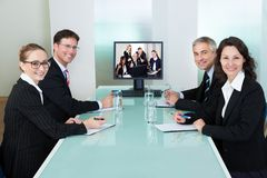 Businesspeople watching an online presentation Stock Photo