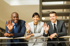 Businesspeople waving office stock photography