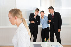 Businesspeople Whispering About Woman Royalty Free Stock Image