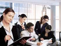 Businesspeople work in team. Young businesspeople work together in office. Daylight, indoor, office royalty free stock photo