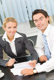 Businesspeople working. Two businesspeople working together at office stock images