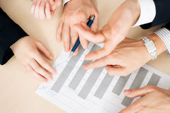 Businesspeople working on charts and graphs Royalty Free Stock Photos
