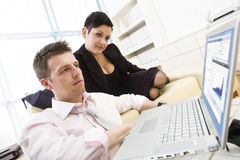 Businesspeople working on computer Stock Images