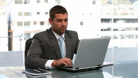 Businesspeople working on a computer. In an office stock footage