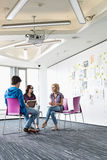 Businesspeople working at creative office space stock photography