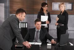 Businesspeople working at desk Royalty Free Stock Photo