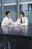 Businesspeople Working At Desk Royalty Free Stock Photos