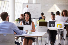 Businesspeople Working At Desks In Modern Office Stock Images