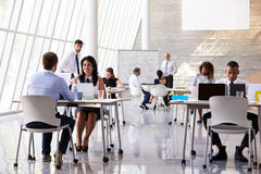 Businesspeople Working At Desks In Modern Office Stock Photography