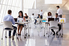 Businesspeople Working At Desks In Modern Office Royalty Free Stock Photography