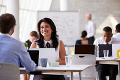 Businesspeople Working At Desks In Modern Office Royalty Free Stock Images